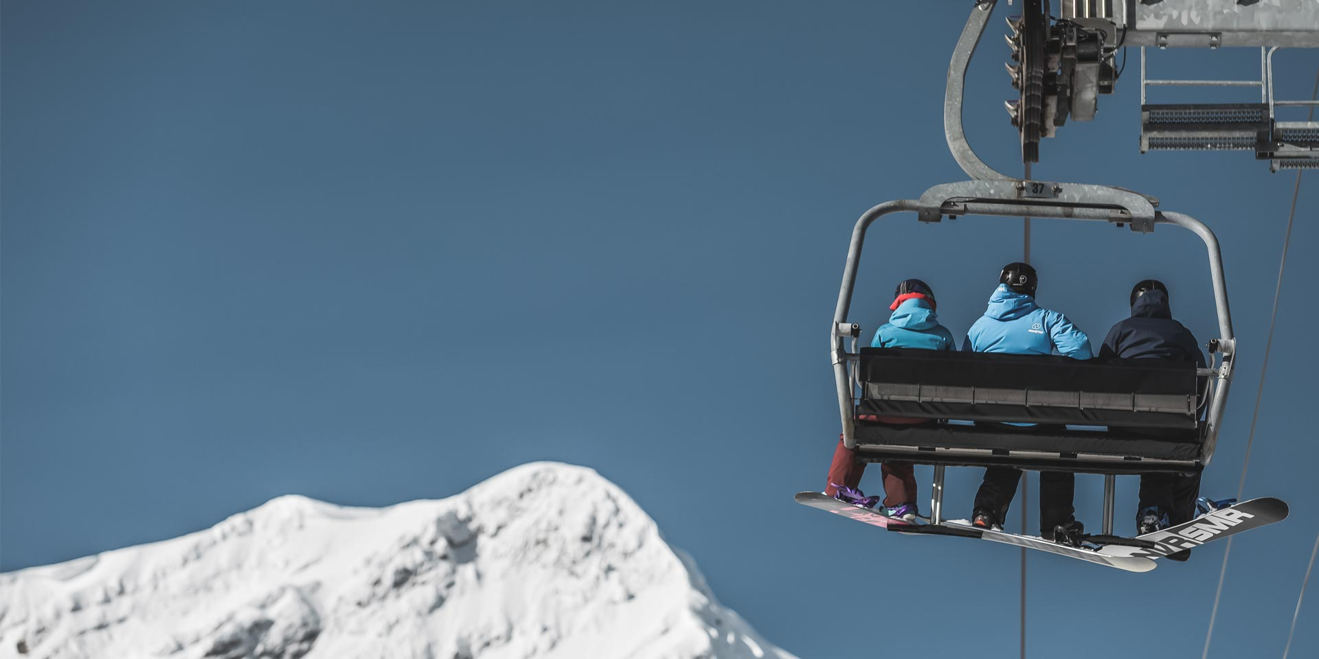 snowboarders-on-chairlift.jpg